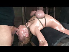 Rough face fucking of girl in tight bondage tubes