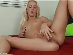 Beauty in black fingernail polish masturbates pussy tubes