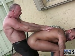 Daddy bear fucks a hot bottom outdoors tubes