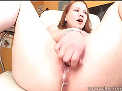 Horny redhead bangs a toy into her naughty pussy tubes
