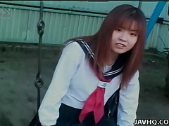 Schoolgirl upskirt on the swing set outdoors tubes