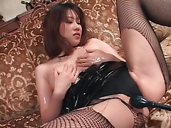 Asian subs in latex and fishnets enjoy toy play tubes