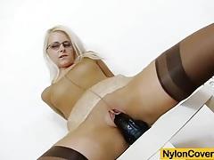 Slender blond-haired full in nylons tubes