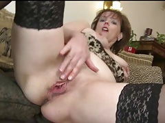 Finger fucking milf wears sexy black stockings tubes