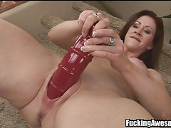 Fit milf fucks cunt with big red dildo tubes