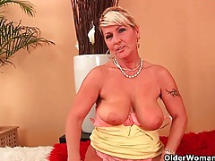 Grandma with hanging big tits is dildoing her hairy cunt tubes
