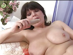Curvy solo mature fucks cunt with a toy tubes
