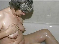 Small tits granny masturbates in the bathtub tubes