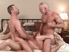 Three hot daddies in a gay anal threesome tubes