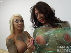 Dani andrews and brandimae - plastic wrapped up tubes