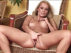 Milf with a perky set of tits fingers her cunt tubes