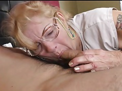 Granny in glasses gives a sexy blowjob tubes
