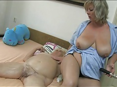 Nurse rubs lotion into her fat granny body tubes