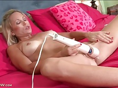 Dripping wet pussy vibrated by a big toy tubes