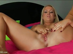 Mom alone in bed masturbates her hot cunt tubes