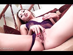 Purple lingerie looks hot on masturbating ladyboy tubes