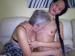 Dirty girl and nasty granny have fun in the bed with a toy tubes