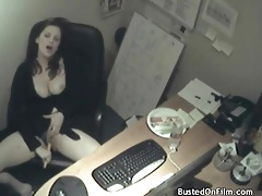 Busty babe fucks a carrot in her office tubes