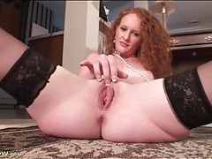 Redhead mom drapes pearl necklace over her pussy tubes