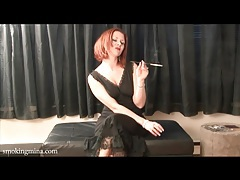 Redhead mina smokes cigarette in a black nightgown tubes
