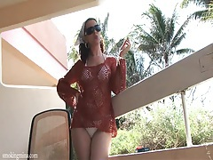 Bikini girl has a hot time smoking on the deck tubes