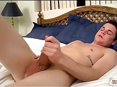 Twink strokes cock as he admire his feet tubes