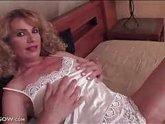 Mature in satin strips and toys her hairy cunt tubes