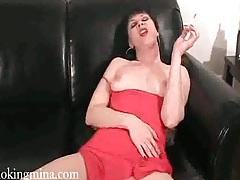 Mina lights up a cigarette and fucks her dildo tubes