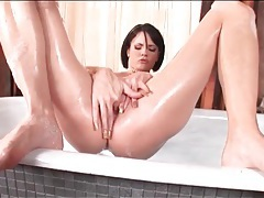Brunette fist fucks hot cunt in the bathtub tubes