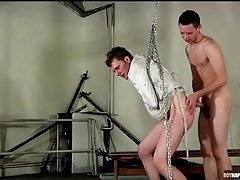 Bound in a straitjacket and fucked from behind tubes