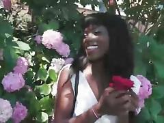 Black girl in the garden shows her pussy upskirt tubes