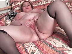 Fat ass chick in black stockings fingers pussy tubes