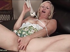 Cute mature blonde vibrates cunt with a toy tubes