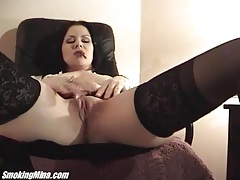 Leather skirt is sexy on smoking girl in stockings tubes