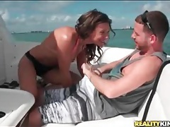 Brunette bikini girl gives a blowjob on the boat tubes
