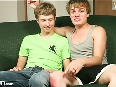 Two super cute twink gay boys kiss on the couch tubes