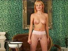 Big breasts blonde girl poses in sheer tights tubes