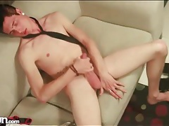 Hot guy with a tie around his neck masturbates tubes