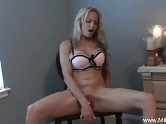 Blonde milf plays on a chair tubes