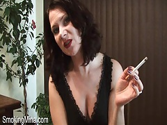 Milf teases lovely cleavage and smokes cigarette tubes