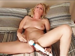 Vibrator on her mature clit makes her moan tubes