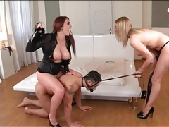 Two sexy ladies dominate guy on a leash tubes