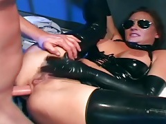 Kinky sex in a latex costume and shiny gloves tubes