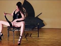 Slim brunette in tight leather dress masturbates tubes