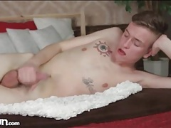 Smooth tattooed guy cums on his stomach tubes