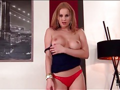 Stripping brunette chick has incredible fake tits tubes