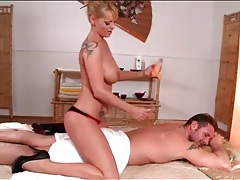 Big titty blonde gives a sexy body massage tubes
