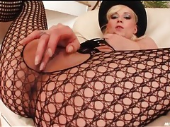 Slim blonde piece of ass in sexy black lingerie tubes