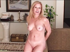 Beautiful blonde milf models her perky tits for us tubes