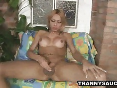 Blonde tranny vixen rubs her tits and tugs on her cock tubes